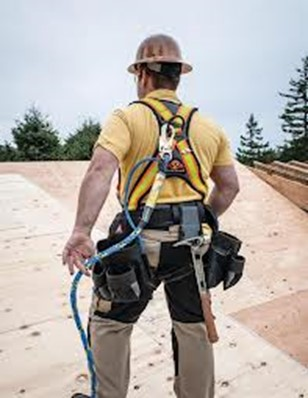 worker wearing fall protection system