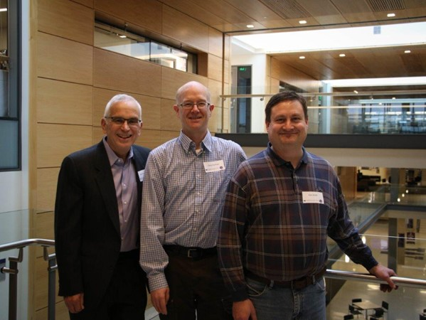 Photo: Provost Jerry Baldasty, Gary Holman, Eric Smith